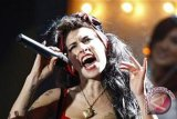 Gaun pengantin penyanyi Amy Winehouse dicuri