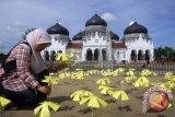 Makna sewindu tsunami bagi korban