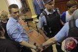 Politisi oposisi Rusia Alexei Navalny berada di pesawat menuju Jerman