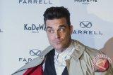 Robbie Williams samai rekor Elvis Presley lewat album