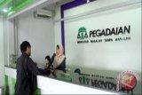 Pegadaian serahkan bantuan program elektrifikasi di Minahasa