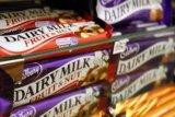 Apa makna logo satu setengah gelas susu dalam Cadbury Dairy Milk?