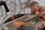 Perajin perak Kotagede berinovasi memproduksi kerajinan tembaga