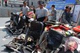 KN Chundamani Bawa Kursi Penumpang AirAsia