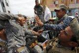 Milisi Syiah Tinggalkan Tikrit Setelah Jarah Kota Ini