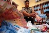 Polda Papua minta bantuan tangkap tersangka investasi bodong