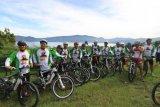 Komunitas Sepeda Internasional Keliling Alam Samosir