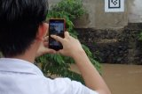 Fujitsu Berhasil Lakukan Pengukuran Muka Air Sungai Gunakan Smartphone dan AR