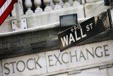 Saham-saham Wall Street ditutup beragam meski Fed pertahankan suku bunga rendah