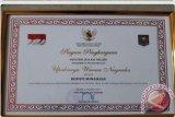 Bupati Sajow Raih Penghargaan Upakarya Wanua Nugraha