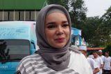 Dewi Sandra di saat Ramadhan