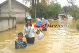 Sungai Bengaris meluap, puluhan rumah terendam banjir