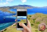 Beberapa kiat mempersiapkan handphone agar liburan menyenangkan