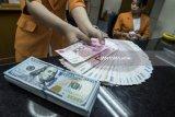 Yuan balik melemah terhadap dolar AS