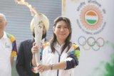 Warga Banyuwangi antusias sambut kirab obor Asian Games meski  deras