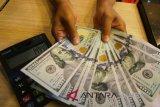 Dolar AS melemah karena investor mencerna laporan