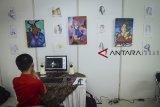 Seorang peserta membuat animasi saat gelaran Baros International Animation Festival (BIAF) di Cimahi, Jawa Barat, Sabtu (27/10/2018). Festival animasi internasional yang diikuti oleh berbagai negara seperti Malayasia, Singapura, Prancis dan New Zeland tersebut digelar untuk mengenalkan dunia animasi kepada masyarakat serta menggaet investor untuk bekerjasama dengan animator lokal. ANTARA JABAR/Raisan Al Farisi/agr.