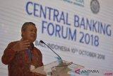 Gubernur Bank Indonesia Perry Warjiyo menyampaikan pandangannya dalam sesi Central Banking Forum 2018 pada Pertemuan Tahunan IMF - World Bank Group 2018 di Nusa Dua, Bali, Rabu (10/10/2018). Forum tersebut membahas berbagai isu perekonomian terutama kebijakan moneter dan pertumbuhan ekonomi. ANTARA FOTO/ICom/AM IMF-WBG//Nyoman Budhiana/aww.