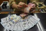 Kurs rupiah melemah dengan kemungkinan tak turunnya suku bunga The Fed
