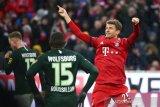 Muenchen melejit ke puncak setelah bantai Wolfsburg 6-0