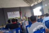 Ditjen EBTKE-Komisi VII DPR-RI sosialisasi dan serahkan bantuan PJU-TS di Minut