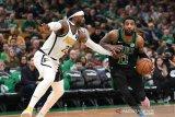 Bntang Boston Celtics Kyrie Irving dan Morris cetak 20 poin