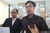 Burhanuddin Muhtadi ke Bareskrim  laporkan empat akun medsos