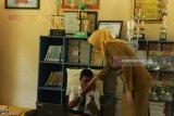 Tangan diinfius seorang siswa SMP Lumajang ikuti UNBK