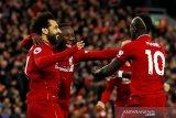 Liverpool gilas Huddersfield dan puncaki klasemen lagi