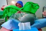 Wakil Bupati Sleman turun langsung memasang IUD peserta baksos KB
