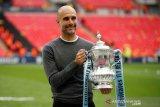 City Trigelar, Guardiola tetap tagih peningkatan musim depan
