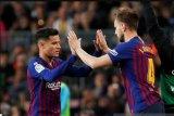 Pique berharap Coutinho bertahan di  Barcelona