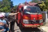 Personel Polsek- petugas Damkar Minsel padamkan kebakaran lahan