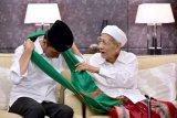 Jokowi unggah foto kenangan bersama KH Maimoen Zubair