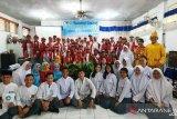 Peserta Siswa Mengenal Nusantara (SMN) berfoto bersama sejumlah siswa SMA 3 Palu, Jumat (16/8). Sebanyak 35 siswa asal Sumut beserta tiga guru pendamping berkunjung ke SMA 3 Palu, yang merupakan salah satu rangkaian program SMN tahun 2019 selama di Sulawesi Tengah.
