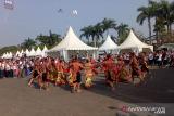 Tari Mandau Bahalai  SMN Kalteng warnai jalan sehat BUMN di Palembang