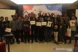 Jurnalis bersama Koalisi Masyarakat Sipil NTB tolak revisi UU KPK
