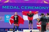 Di kejuaraan dunia Thailand, lifter Lisa Setiawati sumbang emas pertama