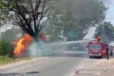 Minibus untuk kulakan BBM terbakar di dekat SPBU Kudus