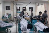 20 orang luka-luka akibat bus pariwisata sekolah terguling
