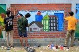 Lukisan mural memperindah dinding Taman Pramuka Pulau Belibis Solok