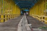 Jembatan kayu Yondo Pamona Poso