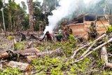 TNI bersama warga buka lahan pembangunan gereja di Papua
