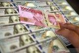 Rupiah tertekan tembus Rp16.500 per dolar AS.