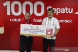 Baznas digandeng JNE donasikan 1000 sepatu bagi korban bencana Palu dan Lombok