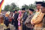 Traditional art is performed in thanksgiving for the Rumah Gadang Kudam Raja Sungai Kambut in Dharmasraya