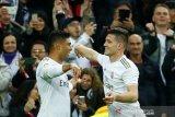 Real Madrid rebut puncak klasemen liga Spanyol, beri tekanan debut Setien di Barca
