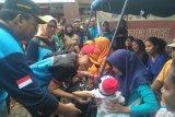 Istri Mensos bantu pulihkan trauma korban banjir