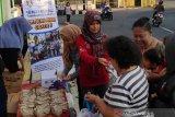 Dinsos-penyandang disabilitas Kota Magelang berbagi nasi bungkus