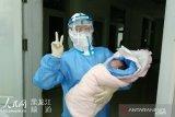 Seorang perempuan terinfeksi virus corona di China melahirkan bayi sehat